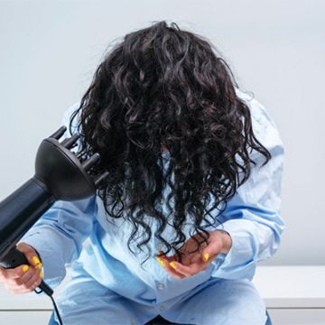 How to part curly hair when it's dry and make it stay